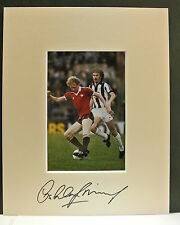 A 10 x 8 inch mount personally signed by Ashley Grimes of Manchester United.