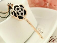 18KGP Rose Gold Crystal key Camellia long Pendants Necklace .China post tracking