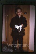 1960s  amateur Kodachrome Photo slide boy in cold weather clothing