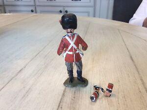 Vintage cast iron grenadier Guard,arms broken but repairable.