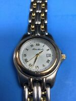 Silver and gold tone women's Eddie Bauer watch with date  - bracelet link band
