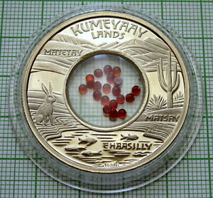 MESA GRANDE KUMEYAAY LANDS 2009 1 $ UNUSUAL TOKEN, RED STONES INSERT IN CAPSULE