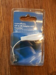 Authentic  Commtel US to UK Adaptor with Capasitor phone plug