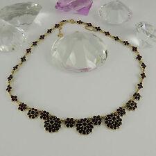 Runde Halsketten und Anhänger im Collier-Stil aus Gelbgold mit Edelsteinen