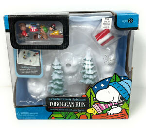 A Charlie Brown Christmas Toboggan Run Music and Motion Base with Micro Figures!