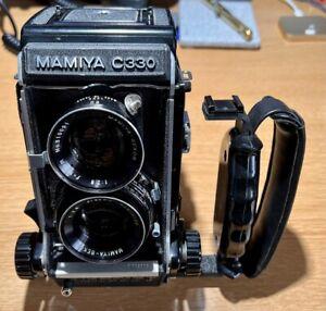 Mamiys C330f  Professional with grip/ prism etc  plus bag.
