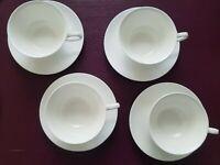 Set of 4 White China Tea Cups with Matching Saucers Plus 1 Bonus Saucer