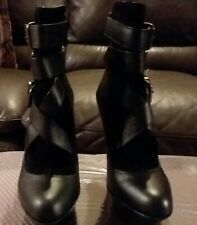 Bebe black leather platform boots 6