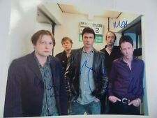 More details for suede autographed 10 x 8 photograph. signed by 4.