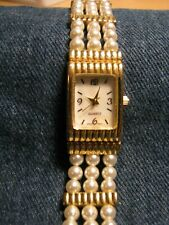 TRIPLE ROWED FAUX PEARL N GOLD TONE N MOTHER OF PEARL DIAL RUNS LOOKS GOODSIZE 7