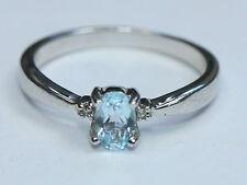 Topaz Birthday Three-Stone Oval Fine Gemstone Rings