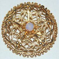 Vintage gold tone round atomic era star pentagram glass moonstone pin brooch