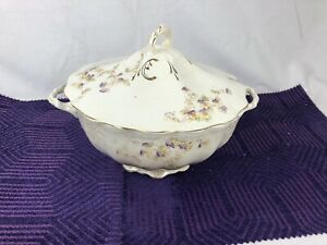 Antique white soup tureen with purple and yellow flowers and gold trim