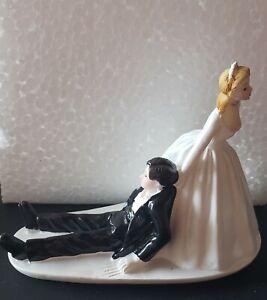 WEDDING CAKE TOPPER FIGURINE BRIDE AND GROOM HUMOR FUNNY COUPLE DRAGGING GROOM