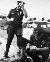 "KENT McCORD AND MARTIN MILNER IN ""ADAM 12"" - 8X10 PUBLICITY PHOTO (DA-381)"
