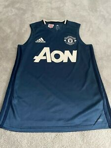 MANCHESTER UNITED OFFICIAL TRAINING VEST TOP  AGE 13-14 -   APPROX 2016 SEASON