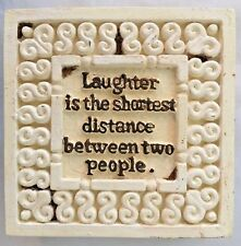 White Wood Sign: Laughter Is The Shortest Distance Between Two People