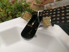 lavabo et robinet Rolex salle de bains