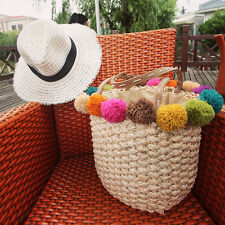 Women's handmade summer beach woven straw bag with colorful pom poms