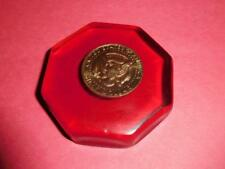 Half dollar in red resin coaster