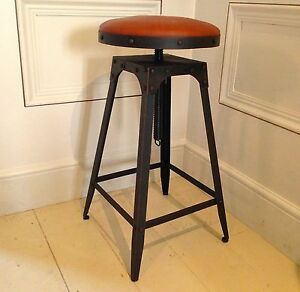 Café-style adjustable stool in Aged Rust colour, 100% leather tan colour seat