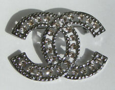 clear crystals brooch . Dark Silver colour metal and