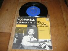 Roger Miller.A.Kansas city star.B.I'll pick up my heart.(3901)