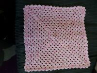 hand crocheted dolls blanket in shades of pink