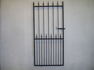 6 ft tall wrought iron  garden / side gate very strong hangs on the left !