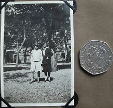 Vintage 1920s photograph Schoolgirl in white gymslip & woman in masculine suit