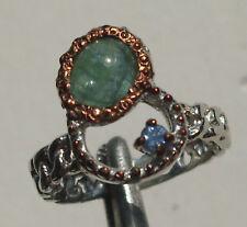 CeS Ring mit einem grünen Turmalin mit Katzenaugen Effekt und Tansanit