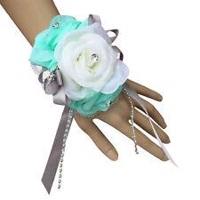 wrist corsage-aqua ivory roses with rhinestone.Pearl stretchable wrist band