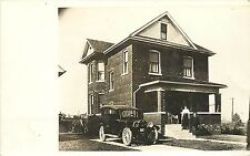 c1910s Real Photo PC; Couple & Brick House, Car in the Driveway, American Dream