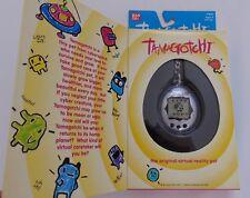 NIB  1997  Tamagotchi Original Virtual Reality Pet Black and Silver