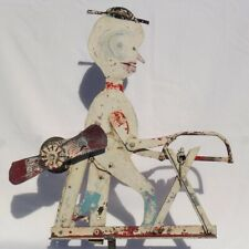 Very folky metal whirligig from found objects w/ great worn and weathered paint.