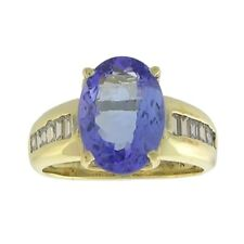 18kt yellow gold 2.0ctw oval blue tanzanite & 0.36ctw diamond accent ring size 4