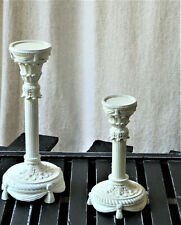 Set of two pillar candle holders, white over butter yellow