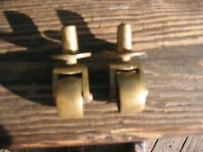 Two Antique brass caster wheels
