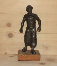 Antique hand made metal figurine man worker