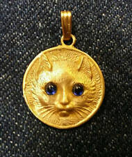 Adorable 14K Gold Cat pendant with genuine Blue sapphire eyes