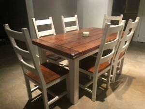 Unique reclaimed wooden dining table with six chairs: 165cm (extends to 265cm).