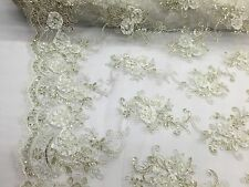 3D RIBBON FLOWERS EMBROIDER WITH SEQUINS ON A IVORY MESH-SOLD BY THE YARD