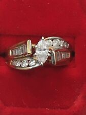 14K YELLOW GOLD ENGAGEMENT RING WITH MARQUISE, ROUNDS AND BAGUETTES