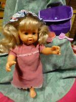 lot=  40cm  jolie poupée BERCHET+ desbrosses  un petit sac mauve pour ranger