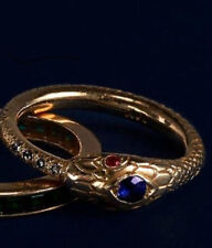 Finely detailed 14k gold snake ring with genuine sapphire, diamonds and rubies