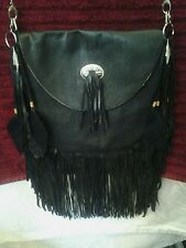 This is a beautiful hand crafted black suede leather long fringe purse.