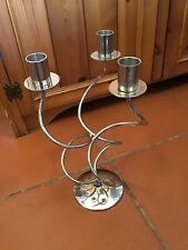 A METAL 3 TWISTED ARM CANDELABRA WITH A SILVER FINISH #W/D