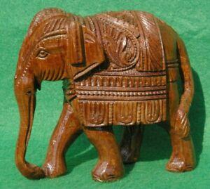 Tall walking Indian Ceremonial Elephant carving in dark well figured hardwood