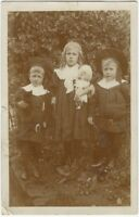 1908 Seriously Strange Children with Queen of All Dolls Real Photo Postcard