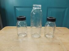 Three Vintage Evenflo Glass Baby Bottles - Two Have Bakelite Lids